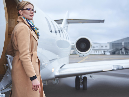 Woman Stepping Off Of Private Jet